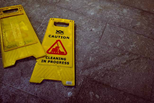 "A ""caution wet floor"" sign that's been knocked over"