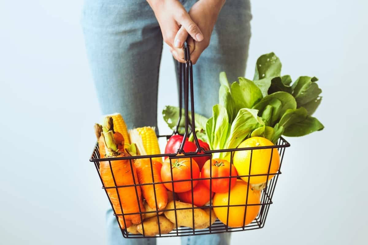 Fruit and vegetables in a wire shopping basket
