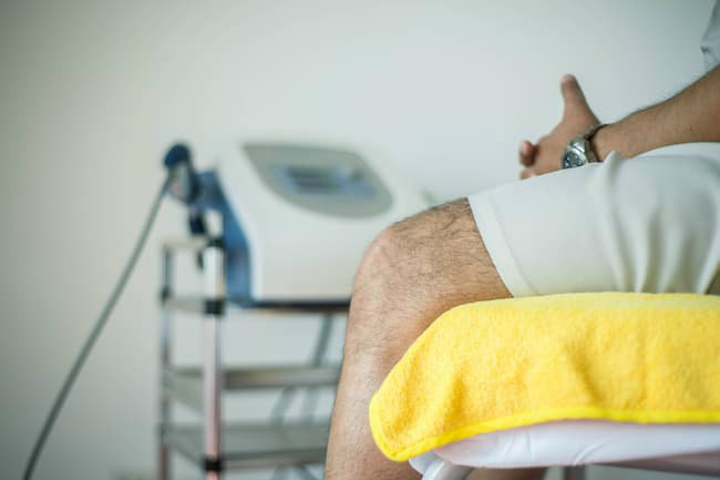 An injured person sitting on a hospital bed